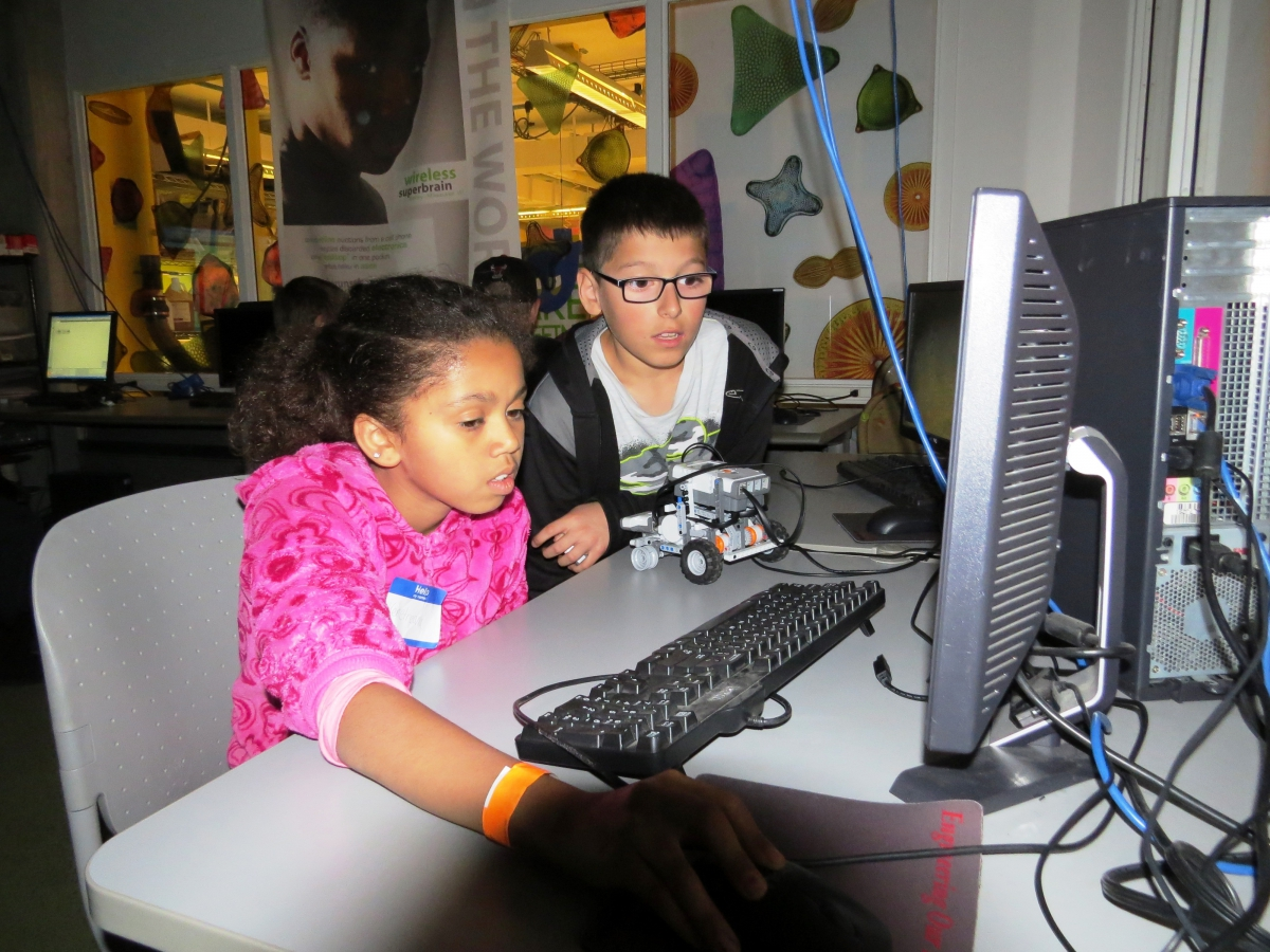 Two children working at a computer