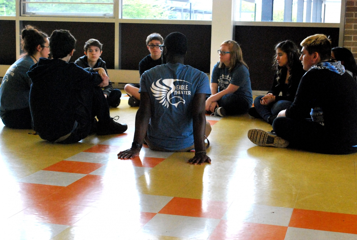 Case students sitting on the floor in a circle having a discussion